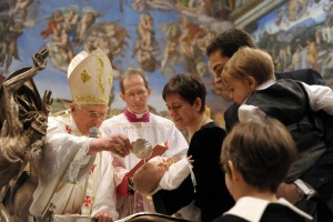 Pope Baptizes a Child in Sistine Chapel
