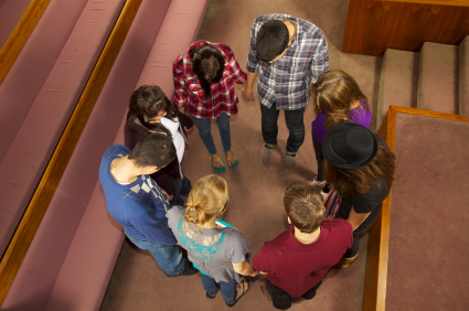 Stock photo of teens praying...