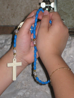 childs+hands+holding+rosary